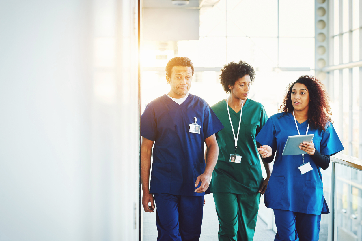 student nurses walking in corridor in light